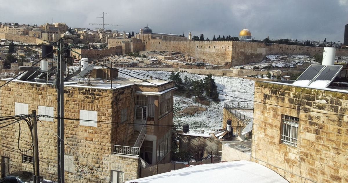 Jerusalem's Dome of the Rock and the Old City covered with snow on January 10, 2013.</p>
