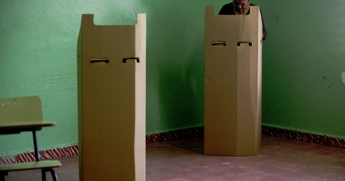 A woman prepares her ballot at a polling station in Santo Domingo during election day in the Dominican Republic on May 20, 2012.</p>