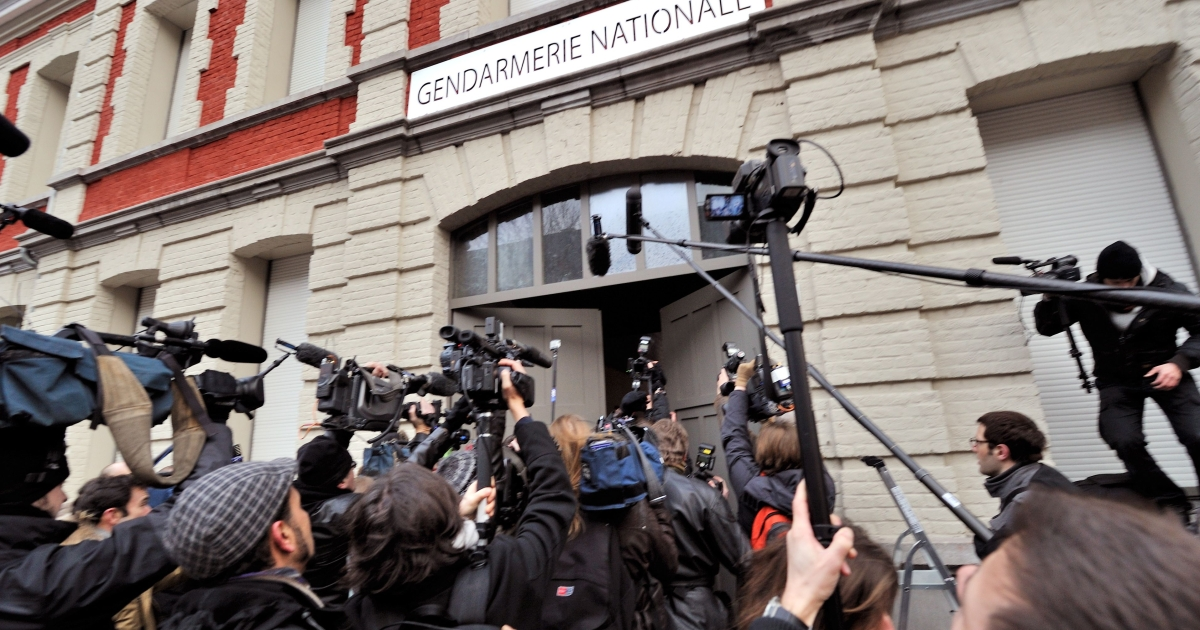 Members of the press film and photograph former IMF chief Dominique Strauss-Kahn arriving at a police station in Lille, northern France on Tuesday morning.</p>