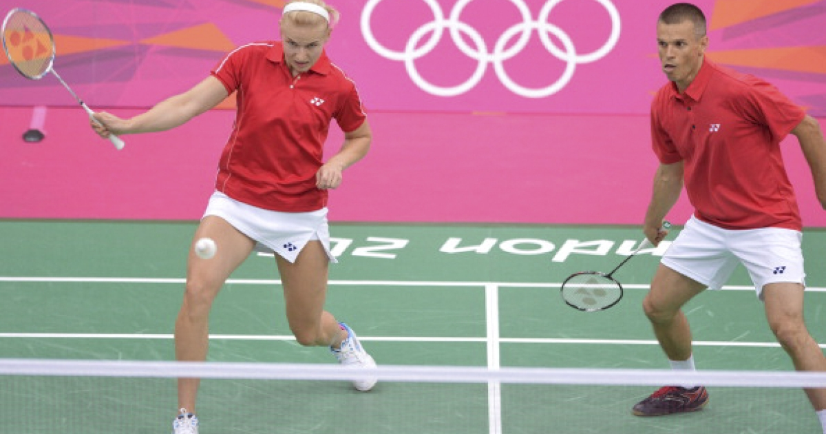 Nadiezda Zieba of Poland (L) is watched by her partner Robert Mateusiak of Poland as she plays a stroke during their badminton mixed doubles group match against Shintaro Ikeda and Reiko Shiota of Japan at The London 2012 Olympic Games in London on July 28, 2012. Poland's Robert Mateusiak and Nadiezda Zieba won 21-8, 22-20.</p>