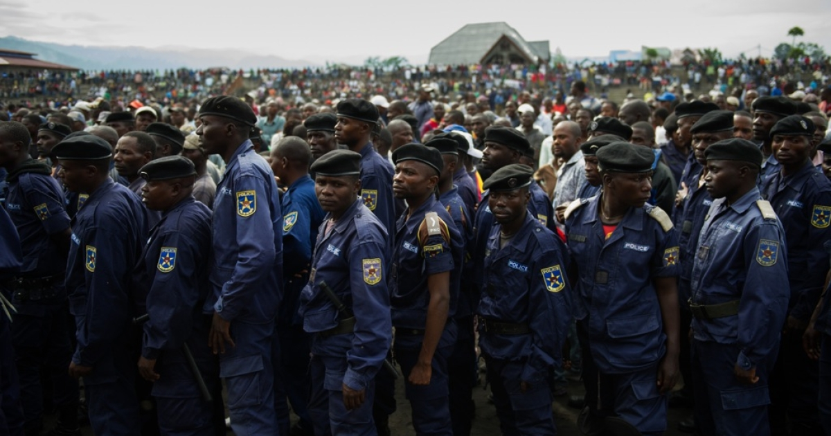 Surrendered police officers stand at the Volcanoes Stadium in Goma, in the east of the Democratic Republic of the Congo, on Nov. 21, 2012. M23 rebels - who took the city the day before - called on any remaining policemen and army soldiers to assemble at the stadium to officially surrender and hand in their weapons.</p>