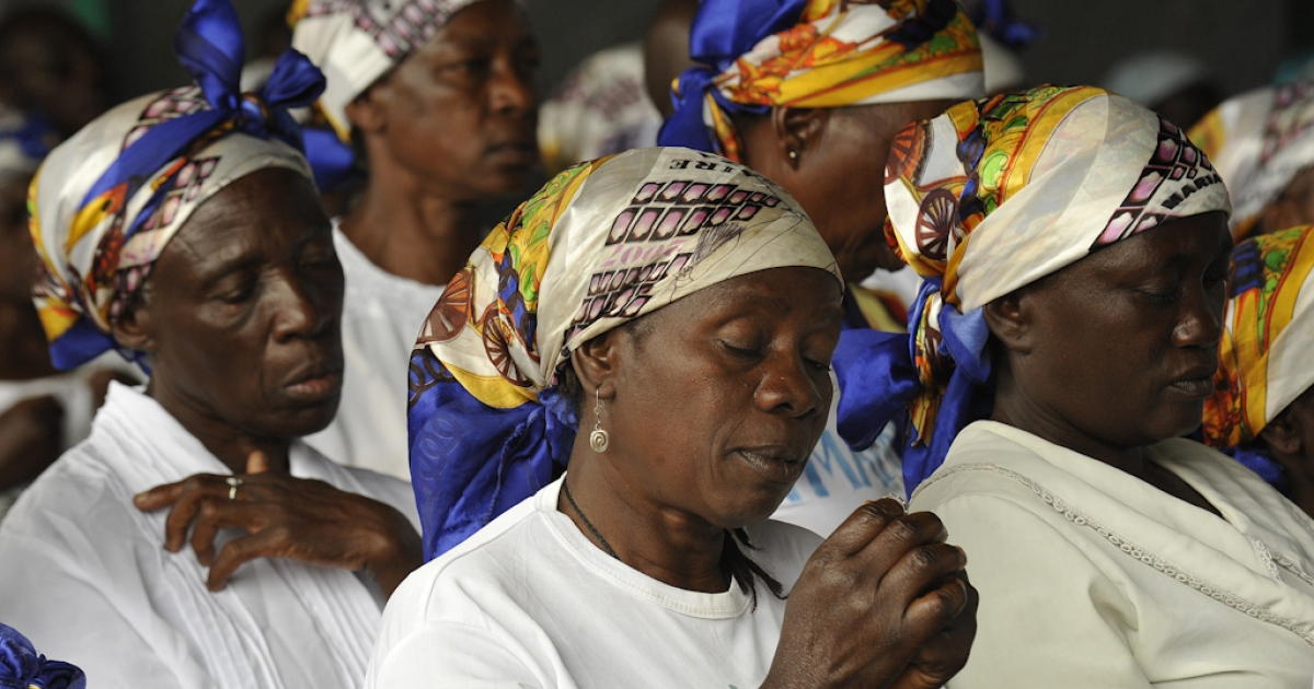 Congolese 'Mama wa Amani' (women of peace) pray for peaceful elections at the Ijize church in Goma on November 27, 2011 on the eve of ahead of presidential and legislative elections. Tensions flared on the eve of Democratic Republic of Congo elections as opposition leader Etienne Tshisekedi called a rally in the capital despite a ban on gatherings followed deadly violence. The polls are only the second here since back-to-back wars from 1996 to 2003, the scars of which are still fresh.</p>
