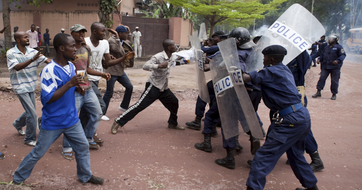 Police clash with opposition supporters as they try to disperse a rally by supporters of Democratic Republic of Congo's 'Union for Democracy and Social Progress' (UDPS) party in Kinshasa on October 6, 2011. Protesters and police were injured and at least eight protesters were arrested after police dispersed protestors who had gathered for a demonstration march demanding more transparency in the November 28 election preparation process.</p>