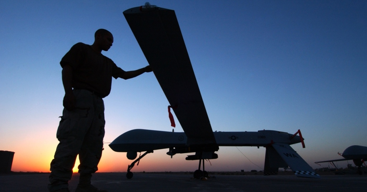 A crew chief completes a post flight inspection of a Predator drone on Sept. 15, 2004 at Balad Air Base, Iraq.</p>