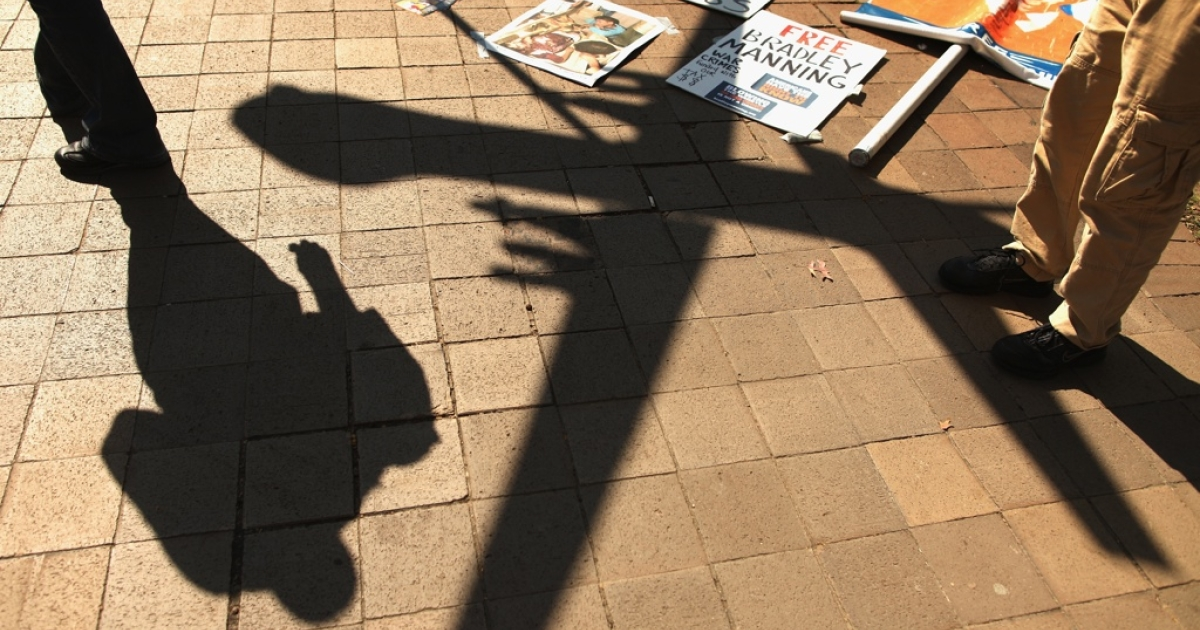 A model of a military drone casts a shadow on the ground during a protest Oct. 6, 2011 in Washington, DC.</p>