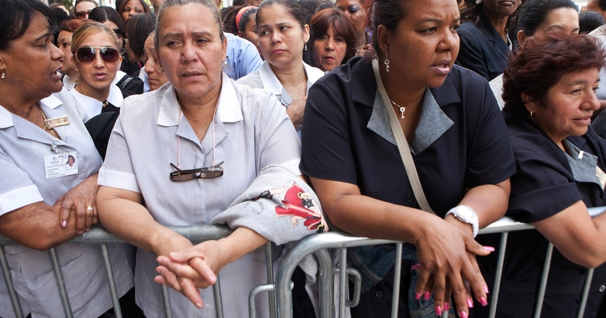 Local New York City hotel housekeepers wait for the arrival of former International Monetary Fund (IMF) chief Dominique Strauss-Kahn to enter Manhattan Supreme Court on June 6, 2011, in New York City.</p>