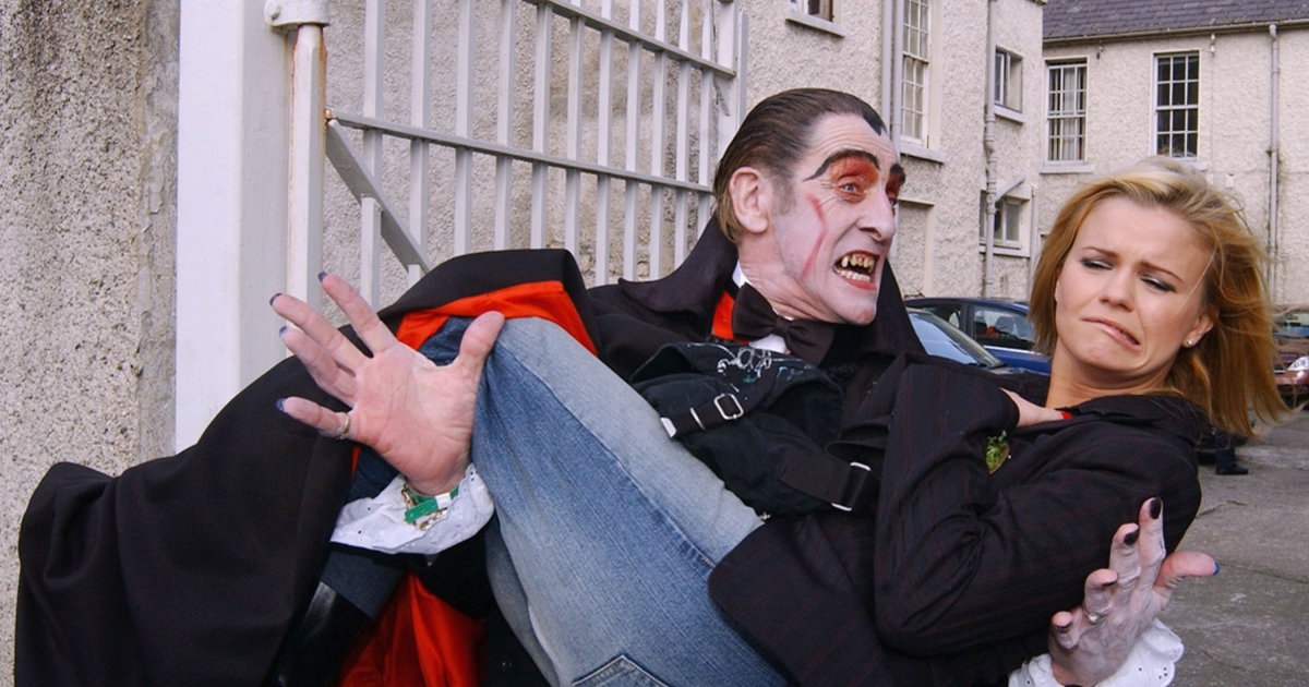Kiss me, I'm Irish. Or not.<br /> A woman poses with Dracula at the St Patrick's Day Parade on March 17, 2004 in Dublin, Ireland.</p>
