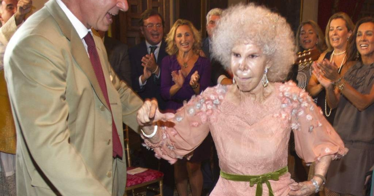 Duchess of Alba, Maria del Rosario Cayetana Fitz-James-Stuart dances with son Cayetano Martinez de Irujo during her wedding ceremony to Alfonso Diez Carabantes held at Duenas Palace on October 5, 2011 in Seville, Spain.</p>