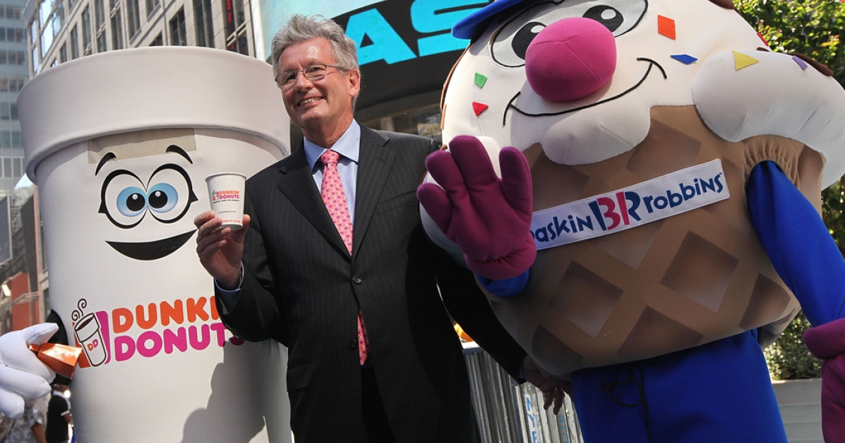 Nigel Travis, chief executive officer and president of Dunkin' Brands Group Inc., celebrates their initial public offering outside the NASDAQ MarketSite on July 27, 2011, in New York City, N.Y. The company plans to open over 300 new restaurants in the US in 2013, including the first public Dunkin' Donuts in California.</p>