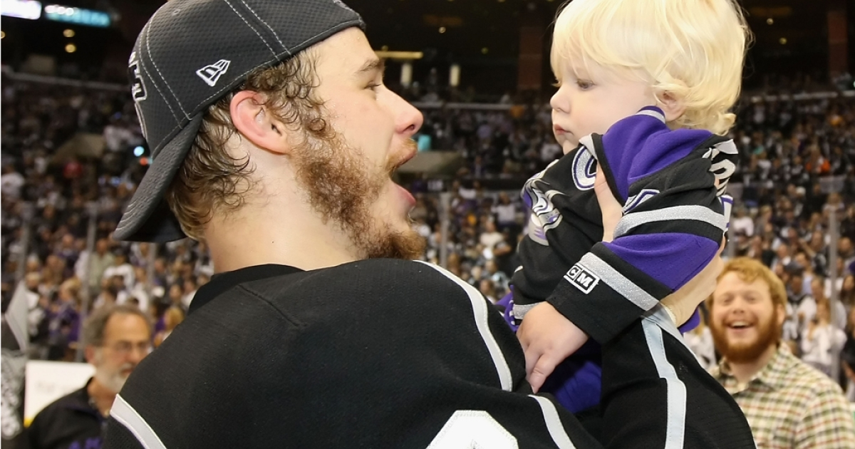 Dustin Brown of the Los Angeles Kings celebrates with his one year-old son, Cooper, after defeating the New Jersey Devils to win the Stanley Cup on June 11, 2012 in Los Angeles.</p>