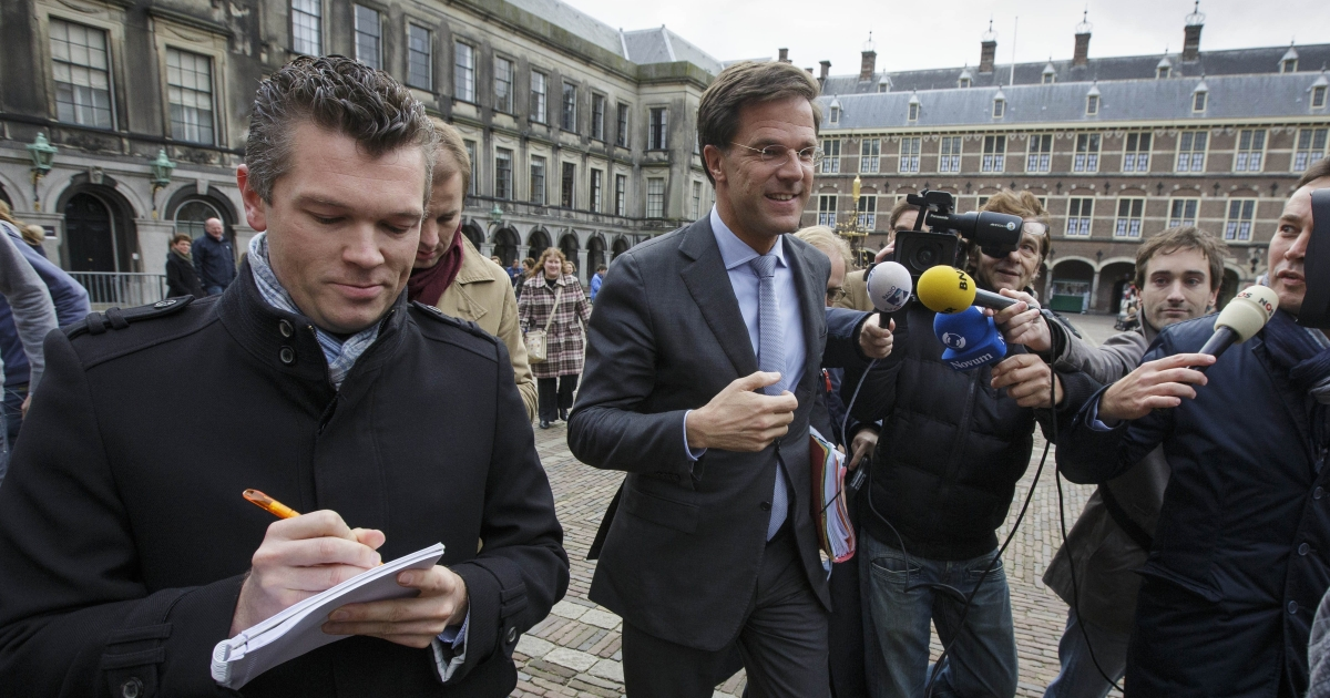 Leader of the Dutch Liberal Party (VVD) Mark Rutte (C) answers journalists' questions as he leaves the parliament building in The Hague on Oct. 25, 2012.</p>