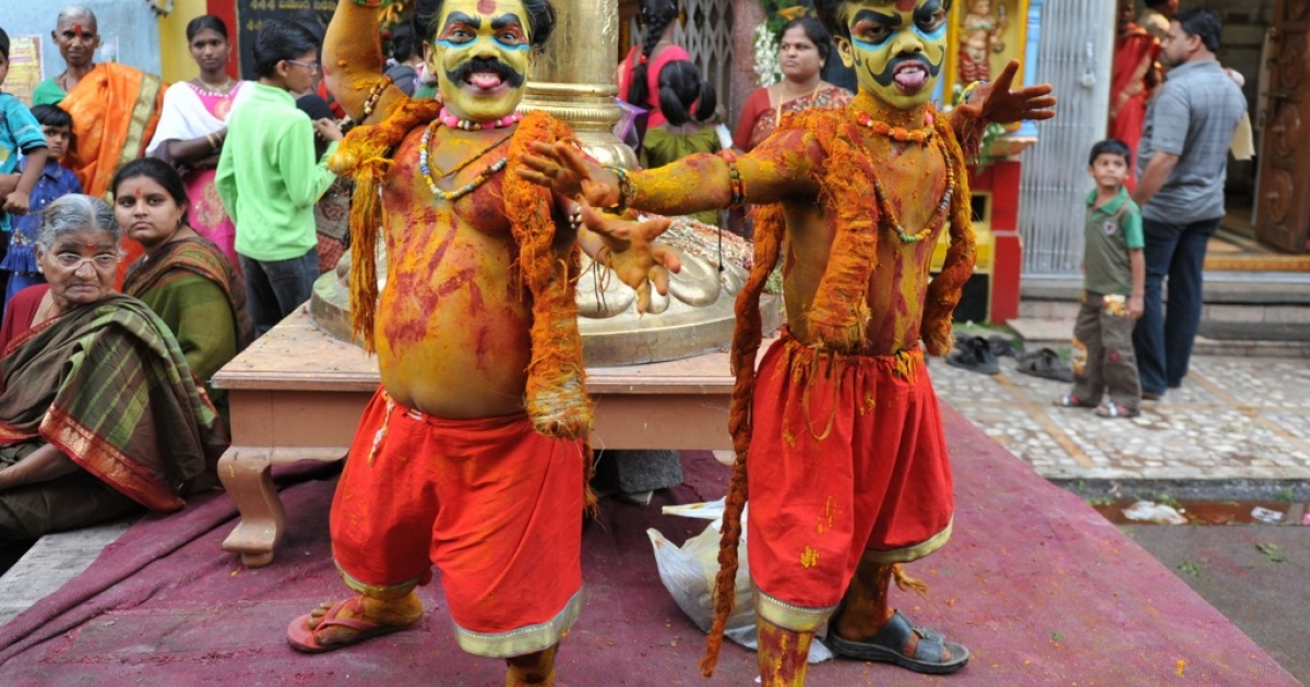 Indian dwarf artists Ashok and Vinay dressed up as Potharaju, the brother of Hindu Goddess of power.</p>