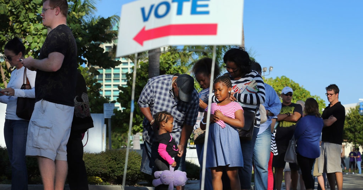 Early voters wait at a polling station at Miami City Hall on October 27, 2012 in Florida. Early voting in one of the important swing states is held for eight straight 12-hour days leading up to the November 6 general election.</p>