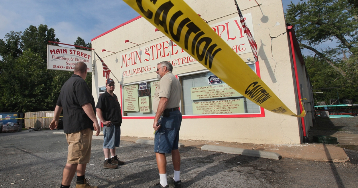Mike Leman surveys damage to his business after an earthquake. The 4.0 earthquake that struck Missouri on Tuesday was felt in 13 other states.</p>