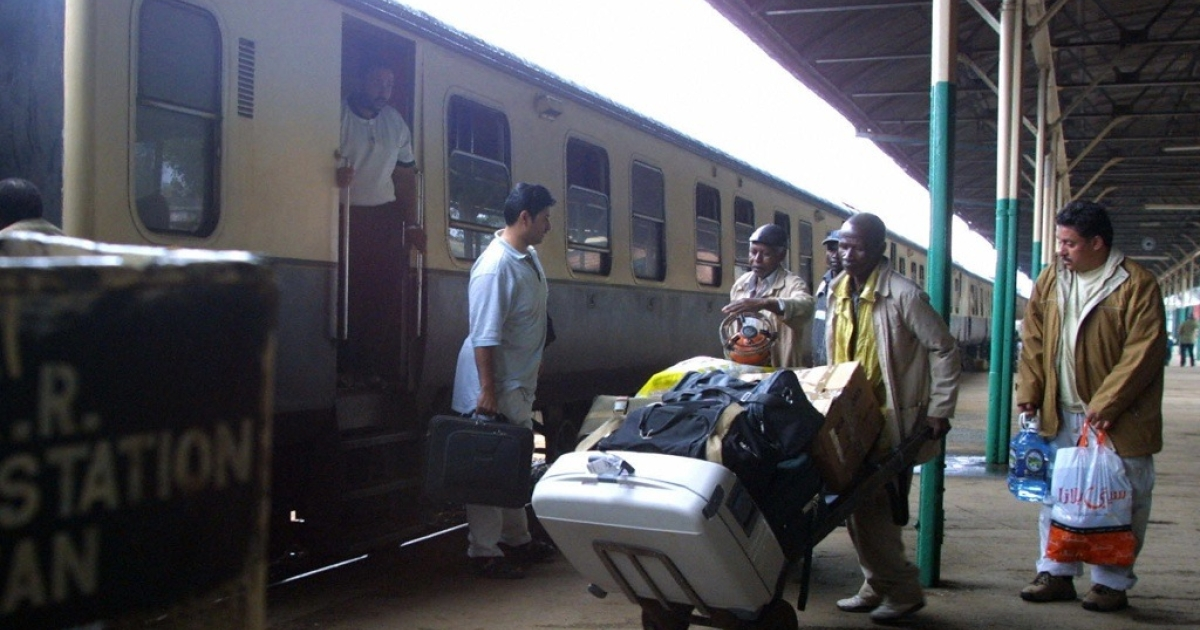 A porter at the Nairobi Railway station ferries baggage for passengers arriving from Mombasa. Private equity firms have invested in a railway line between Kenya and Uganda.</p>