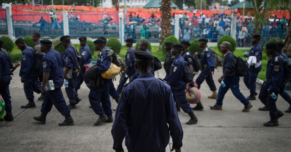 Congolese National Police-officers gather inside the central bank complex in the city of Goma in the east of the Democratic Republic of Congo on December 1, 2012. Hundreds of Congolese M23 rebels began a withdrawal on December 1 from Goma as promised under a regionally brokered deal, after a 12-day occupation of the city.</p>