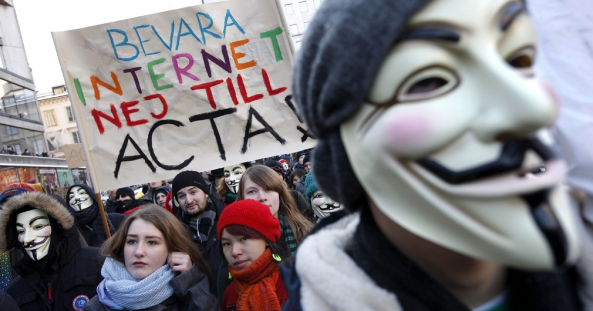Protestors, some wearing Guy Fawkes masks, take part in a demonstration in Stockholm on February 4, 2012 to protest against the Swedish government's plan to ratify the Anti-Counterfeiting Trade Agreement (ACTA). The banner reads 'Preserve the internet say no to ACTA! '</p>