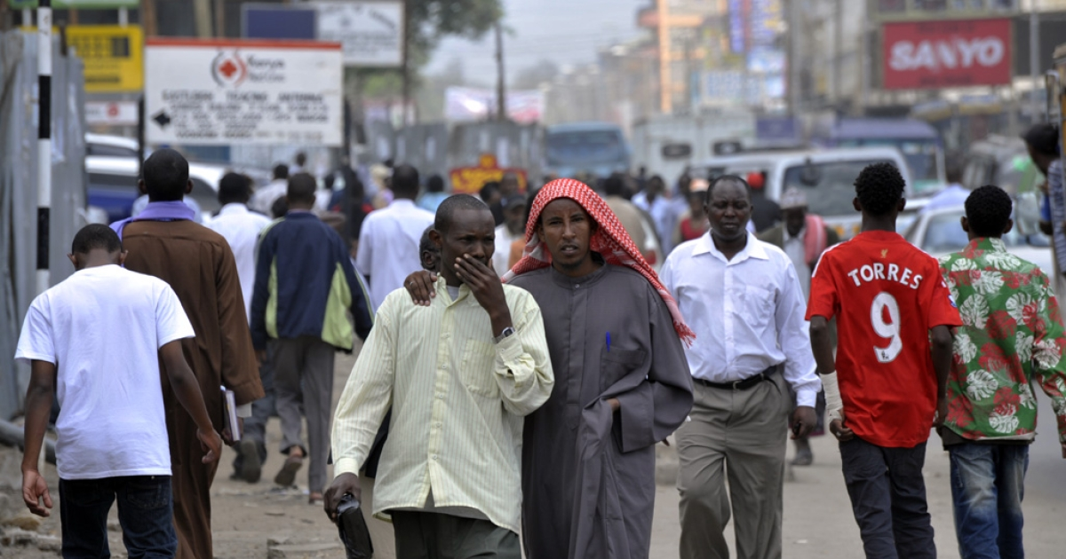 Residents walk through Eastleigh, a neighborhood of Nairobi known for its Somali population, walk on January 18, 2010. Kenyan police detained 300 illegal Somali immigrants during a sweep that followed a deadly protest at Nairobi's main mosque. The raid on Eastleigh neighbourhood was carried out by the elite General Service Unit and the anti-terrorism police unit following allegations by the government that Somalia's hardline Al Shabaab group infiltrated the demonstration.</p>
