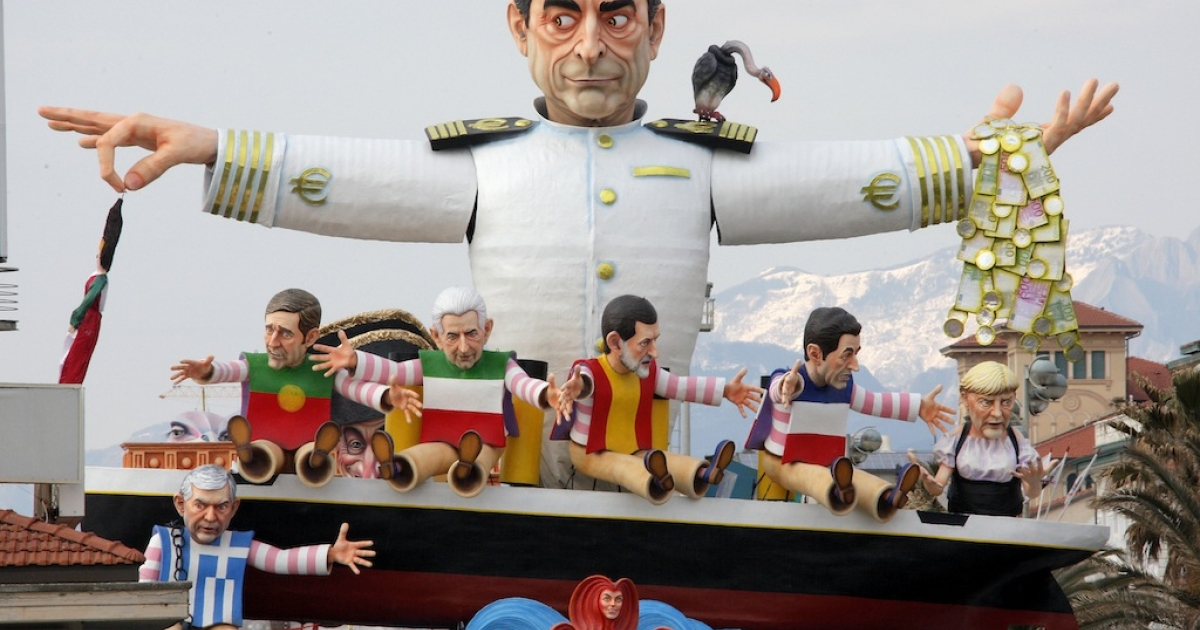 A carnival float called 'But, where is the crisis?' shows the head of the European Central Bank Mario Draghi (top) and European leaders during the carnival parade in Viareggio, Italy on Feb. 5, 2012.</p>