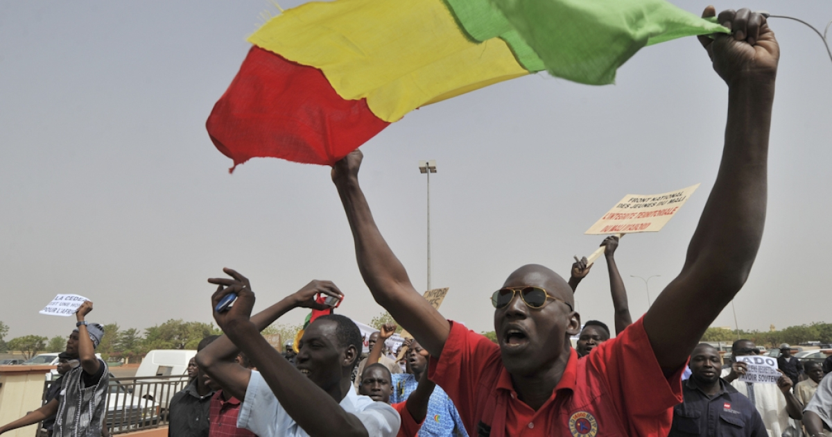 Malian military junta supporters gesture at the airport in Bamako, Mali's capital, on March 29, 2012. A bid by west African leaders to seek a return to democratic rule in Mali fell apart Thursday when the team turned back mid-air after a pro-coup demonstration in Bamako airport.</p>