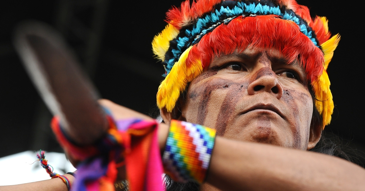 A warrior of Ecuador's indigenous Shuar community protests against a Chinese copper mine set to be built in the country's Amazon region.</p>