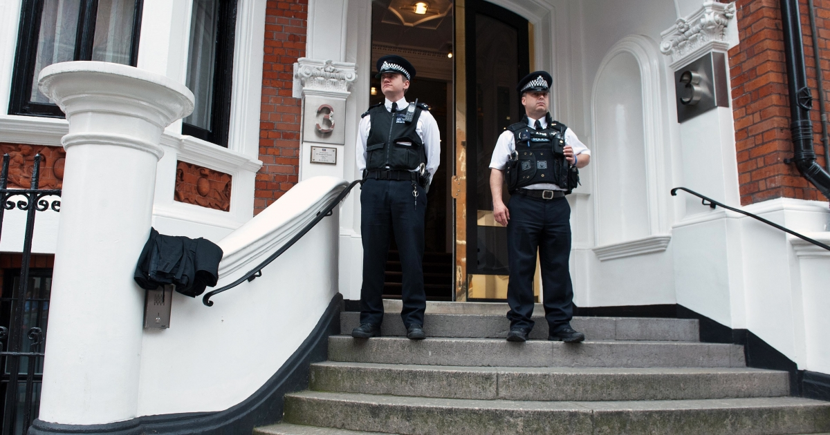 London police wait outside the main door of the Ecuadorean embassy, where WikiLeaks founder Julian Assange is holed up.</p>
