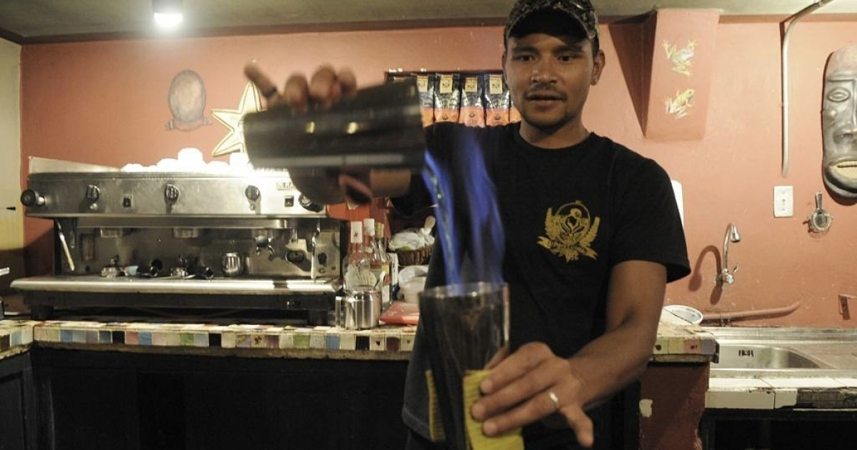 A barman prepares a cocktail at Pobre Diablo, a traditional bar, restaurant and concert hall in Quito, Ecuador.</p>