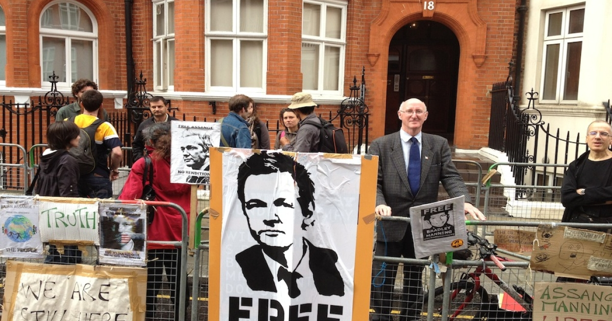 Protesters and Assange supporters stand outside London's Ecuadorian embassy. The Wikileaks founder remains inside awaiting a decision on his plea for asylum.</p>