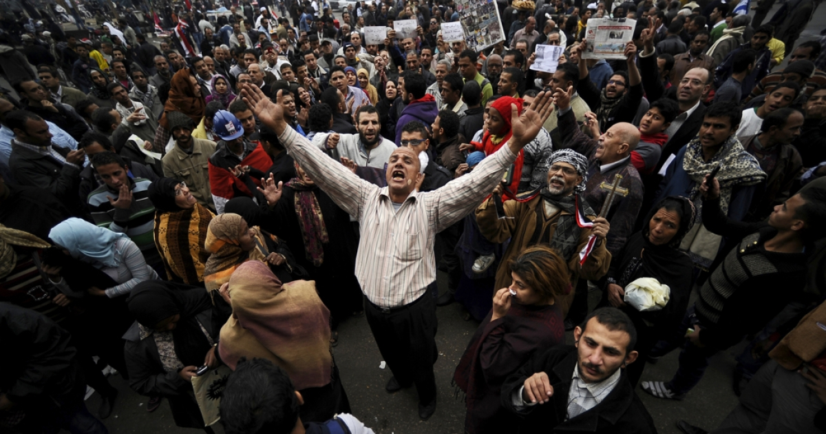 Egyptian protesters chant slogans during a demonstration in Cairo's Tahrir Square in Dec. 2011. What will happen on the first anniversary of Egypt's uprising next week is anybody's guess.</p>