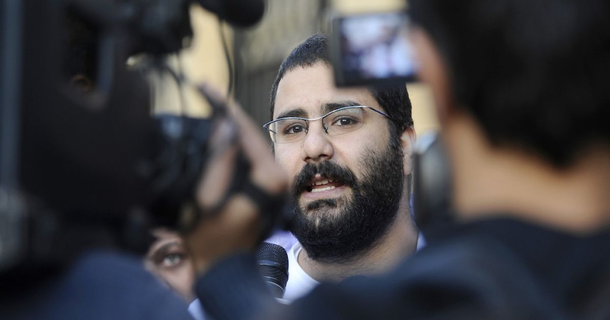 Egyptian blogger and activist Alaa Abdel Fattah speaks to the press following his release from the police headquarters in Cairo in December. In a new report, Reporters Without Borders says Egypt is on its way to becoming an