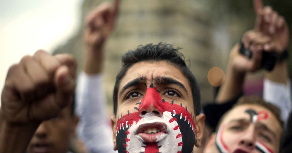 An Egyptian anti-regime protester shouts slogans during a demonstration calling for the interim military rulers to step down in Tahrir Square in Cairo, Egypt. Reports that jailed blogger Maikel Nabil would be released ahead of the one-year anniversary of Egypt's uprising had raised hopes for protestors.</p>