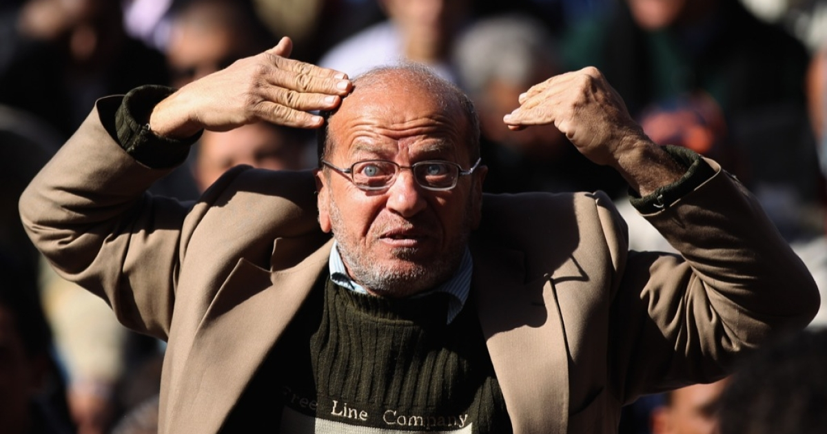 An Egyptian man reacts in Tarhrir Square during Friday prayers on Jan. 27, 2012 in Cairo, Egypt. People prayed in the square just days after the tens of thousands celebrated in Cairo's Tahrir Square marking the first anniversary of the uprising which toppled President Hosni Mubarak.</p>