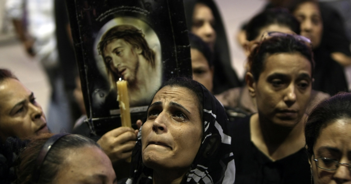 Coptic Egyptians attend a service at the Abbassiya cathedral in Cairo on Oct. 12, 2011 to mourn those killed during recent clashes with security forces.</p>