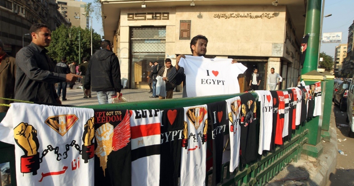 A street vendor displays t-shirts on March 27, 2011 in Cairo's Tahrir Square.</p>