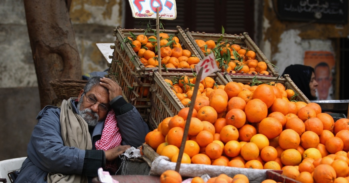 A man sells oranges in the Magra El-Oyoun market on Jan. 24, 2012 in Cairo, Egypt. The country is struggling with falling tourism figures and rising unemployment following last year's revolution, which ousted President Hosni Mubarak.</p>