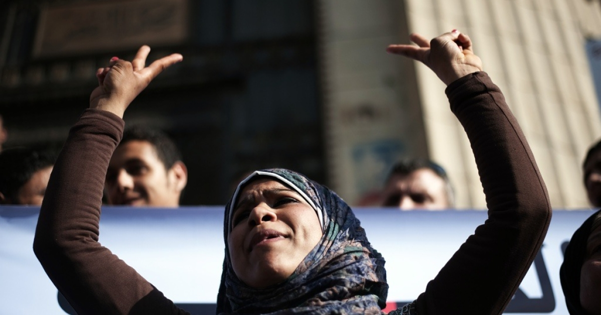 An Egyptian anti-military protester flashes the sign for victory during a demonstration in Cairo on May 6, 2012.</p>