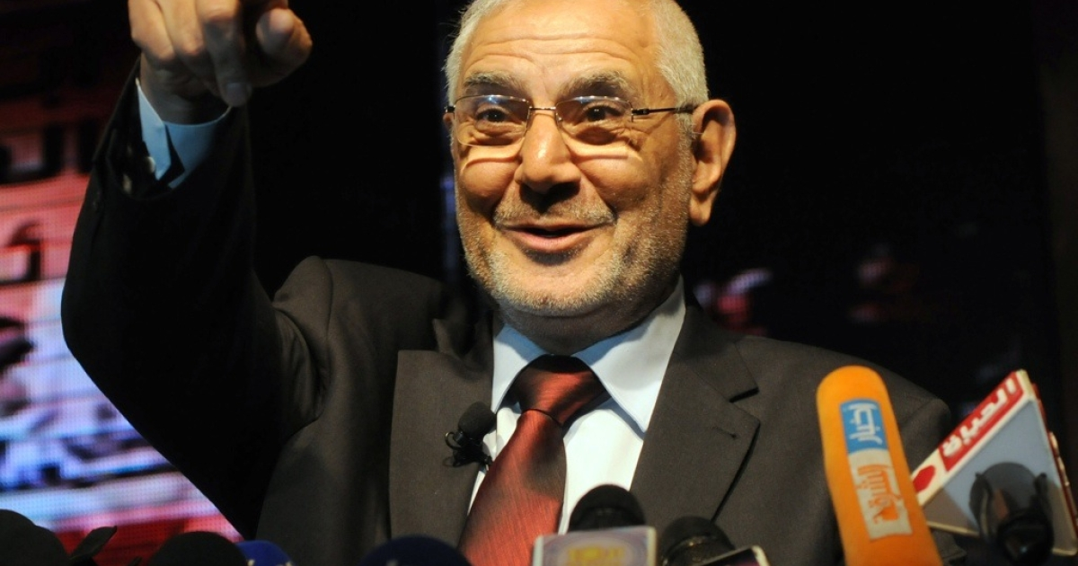 Egyptian former Muslim Brotherhood member and now presidential candidate Abdelmoneim Abul Fotouh gestures to the crowd on stage during an election campaign rally on April 2, 2012, in Cairo.</p>