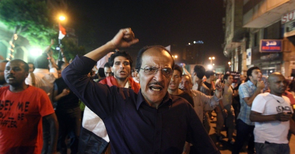 An Egyptian man shouts slogans during a demonstration against the results of the first round of the elections in Cairo on May 28, 2012.</p>