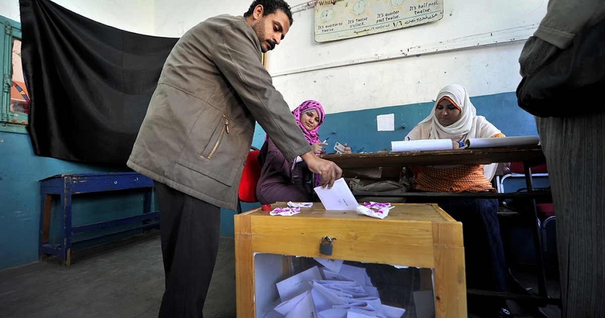 An Egyptian man casts his ballot at a polling station in Cairo on March 19, 2011. Egyptians got their first taste of democracy in a referendum to a package of constitutional changes after president Hosni Mubarak was forced to relinquish his 30-year grip on power last month in the face of mass street protests.</p>