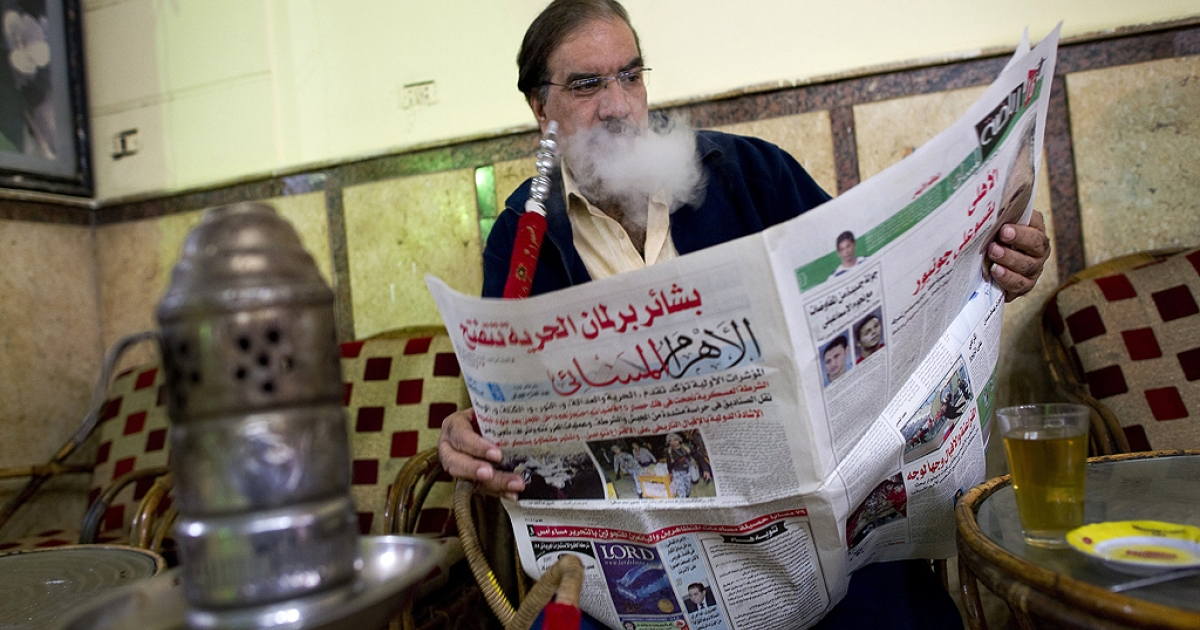 An Egyptian man reads a newspaper at a cafe in the Zeitun neighbourhood of Cairo on November 30, 2011. Egypt's Islamists claimed they were headed for victory in the opening phase of the country's first post-revolution election after two days of peaceful polling that won international plaudits.</p>
