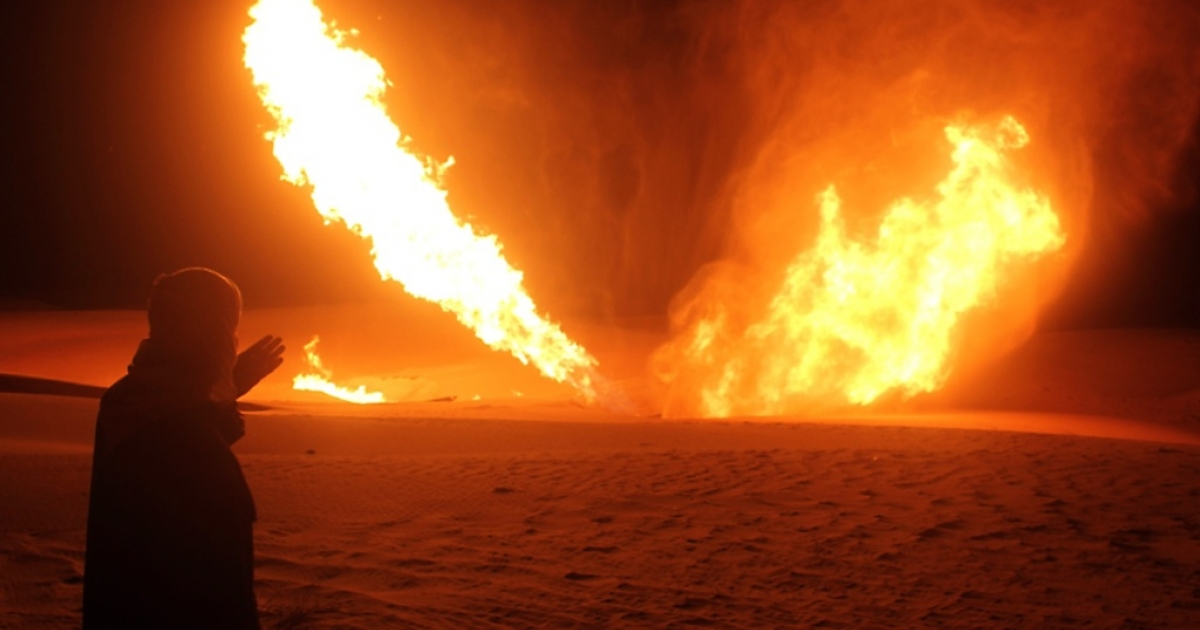 An Egyptian man looks at flames rising from a pipeline that delivered gas to Israel and Jordan after it was hit by an explosion in November 2011.</p>