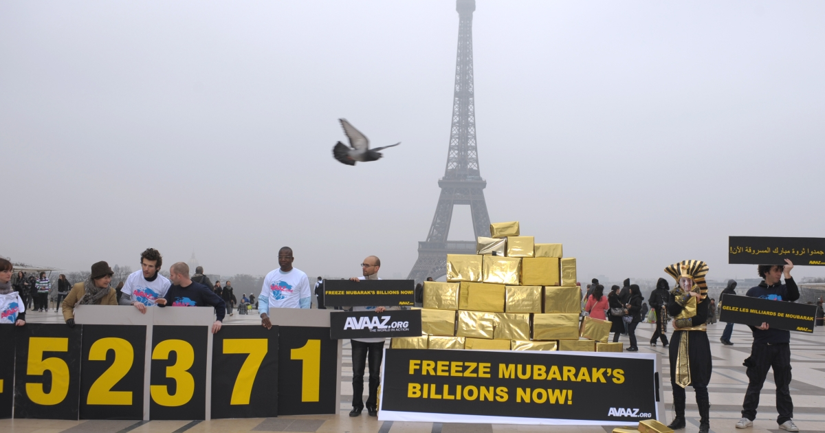 People take part in a demonstration to ask EU countries to freeze the assets of former Egypt president Hosni Mubarak, on the Trocadero square near the Eiffel Tower in Paris on Feb. 18, 2011. .</p>