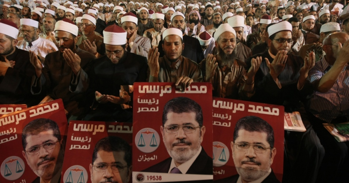 Supporters of Mohamed Morsi, the Muslim Brotherhood's candidate in Egypt's presidential election, pray during the party's last campaign rally in Cairo on May 20, 2012.</p>