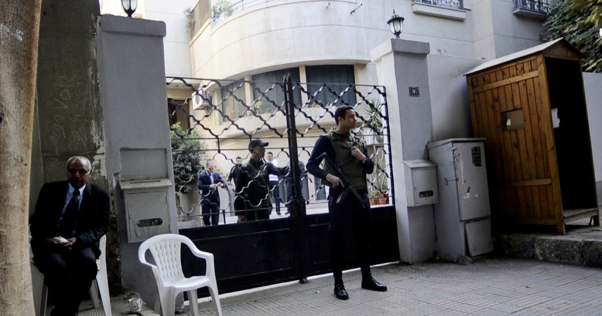 Egyptian soldiers stand guard in front of the US National Democratic Institute, an NGO (non-governmental) rights group in downtown Cairo on December 29, 2011. Egyptian police were searching the Cairo offices of American and Egyptian rights group following orders by the prosecution service which is investigating how the rights groups are financed.</p>