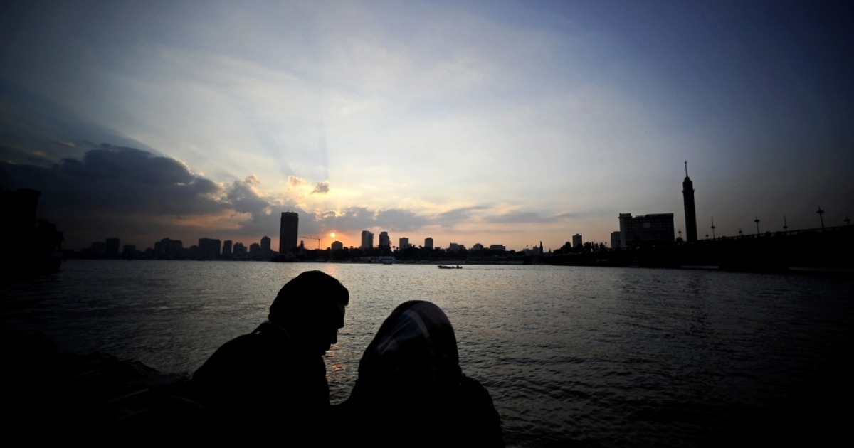 An Egyptian couple enjoys sunset on a bridge overlooking the Nile in Cairo on Dec. 28, 2011.</p>
