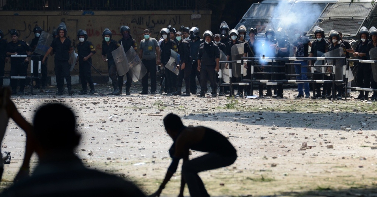An Egyptian riot police officer fires tear gas towards protesters during clashes with police near the US embassy in Cairo on Sept. 13, 2012.</p>