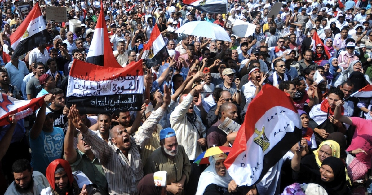 Egyptian protesters shout slogans as they gather in Cairo's Tahrir Square on September 30, 2011 during a mass rally to reclaim the revolution amid anger over the military rulers' handling of the transition.</p>