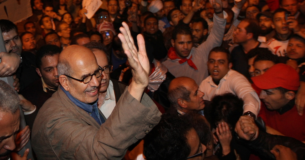 Opposition leader Mohamed ElBaradei waves to supporters in Tahrir Square on January 30, 2011 in Cairo, Egypt.</p>