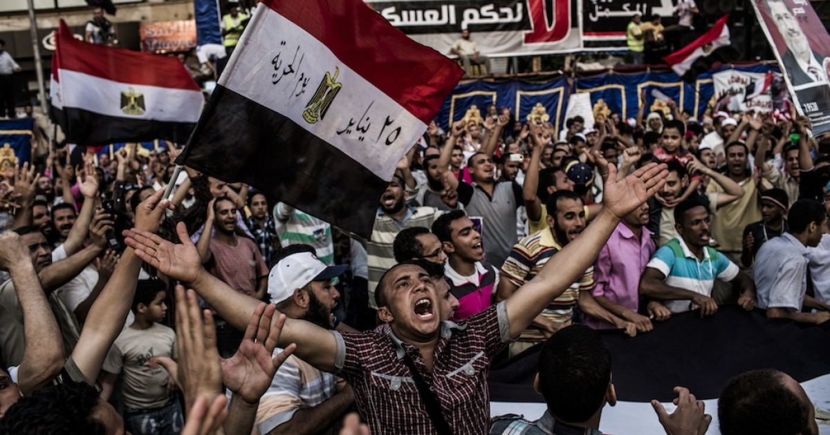 Supporters of Mohamed Morsi, the Muslim Brotherhood's candidate, protest against Egypt's military rulers in Tahrir Square after officials postponed until Sunday the announcement of a winner in last weekend's presidential run-off.</p>
