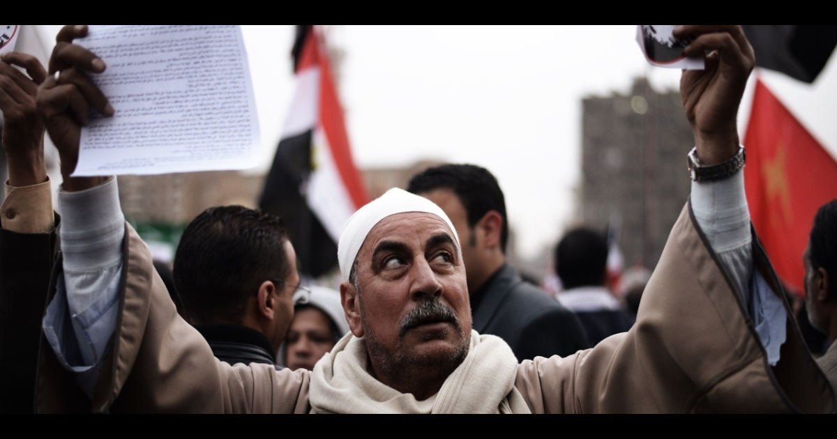 An Egyptian man takes part in a march towards the presidential palace in Cairo on Dec. 4, 2012.</p>